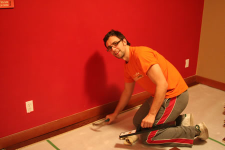 andy laying wooden flooring